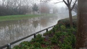 The River Wey has burst its banks.