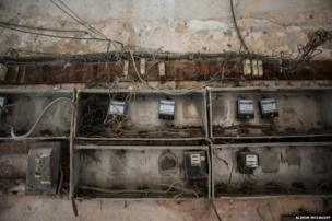 Fuse boxes in the entrance of a building in Old Havana - These dangerously worn and outdated fuse boxes can be seen in the entrances of most of the buildings in Havana.