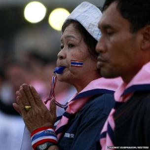 An anti-government protester blows her whistle during a rally at the Democracy Monument in central Bangkok (December 27, 2013)