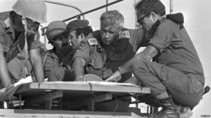 Ariel Sharon, second right, as major general, with his troops in Sinai on 10 October 1973
