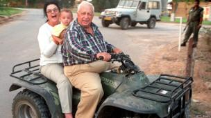 Ariel Sharon with his wife Lily and grandchild Rotem at their farm near Sderot on 9 October 1998