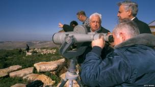 Ariel Sharon, as infrastructure minister, points out settlement sites to PM Benjamin Netanyahu on 28 December 1997
