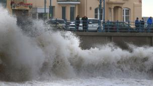 At Porthcawl, the sea was lashing against the wall
