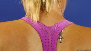 Maria Sharapova of Russia shows off a necklace during a practice session