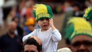 A boy attends a ceremony to celebrate Australia's cricket team victory over England in the Ashes Test series at the Sydney Opera House on 7 January 2014