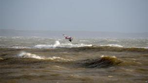 Windsurfers taking advantage of the weather at Mudeford in Dorset