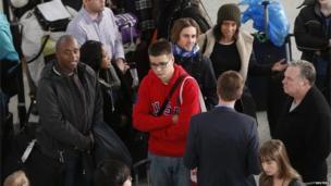 Passengers at JFK airport in New York (6 Jan 2014)
