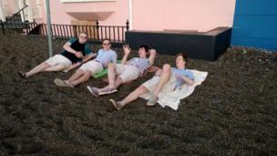 Students on shingle at Aberystwyth promenade
