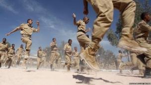 Newly recruited members of the Yemeni military police force exercise at their barracks in Sanaa
