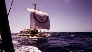 Raft at sea with a square sail
