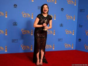 Actress Elizabeth Moss poses with her Golden Globe award