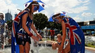 Tennis fans take a dip in a fountain to cool off at the Australian Open.