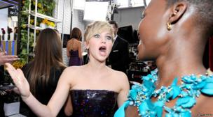 Jennifer Lawrence greets Lupita Nyong'o