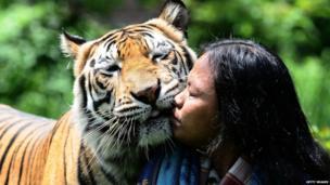 Abdullah Sholeh hugging his best friend Mulan Jamilah, a Bengal tiger.