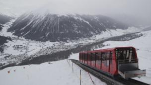 A cable train makes its way up the Weissfluhjoch mountain at the Parsenn ski arena in Davos, Switzerland