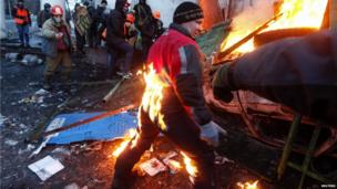 A pro-European integration protester catches fire during clashes with police in Kiev January 20, 2014