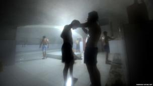 Afghan men wash at a traditional bath house in Mazar-i-Sharif