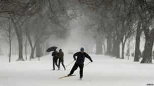 A man on cross country skis as he makes his way along the National Mall as a snow storm hits Washington January 21, 2014.