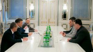 Ukrainian President Viktor Yanukovych, second left, meets with opposition leader, Oleh Tyanybok, right, Vitali Klitschko, second right, and Arseniy Yatsenyuk, in Kiev on Wednesday