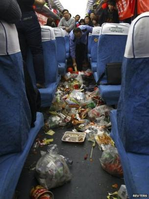 Rubbish being collected on a train travelling from Shenzhen to Zhengzhou