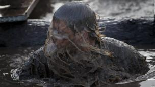 Tough Guy competitor in muddy water