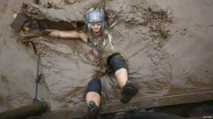 Tough Guy competitor falls into muddy water