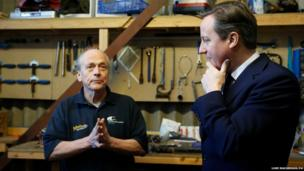 Prime Minister David Cameron (right) with boat builder and restorer John Watson during a visit to small businesses at Lots Ait Boatyard in Brentford, west London.