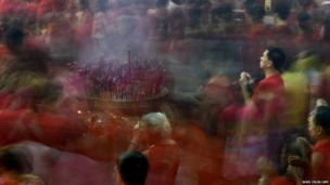 Chinese Filipinos pray at the Seng Guan Temple in Manila
