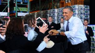 US President Barack Obama greets employees at the Costco in Lanham, Maryland
