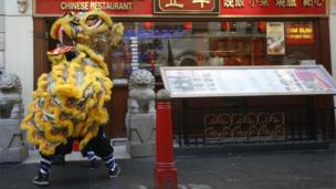 A Lion Dance is performed at the entrance of a restaurant