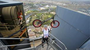 Krystian Herba, a Polish extreme cyclist jumps up the steps of Eureka Tower on a bicycle as he breaks a Guinness World Record in Melbourne, Australia