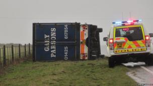 Overturned lorry on the A35 between Bridport and Dorchester.