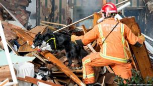 Essex Fire Service Urban Search and Rescue Team check the Cloes Lane debris for further casualties
