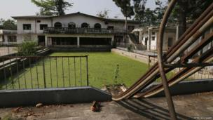 The green swimming pool and old slide at Bokassa's former palace - Central African Republic, February 2014