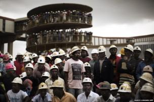 Miners of Harmony Gold's Doornkop mine gather to mourn their colleagues who died in a mining accident