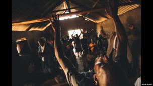 People praying in a church in western Kenya