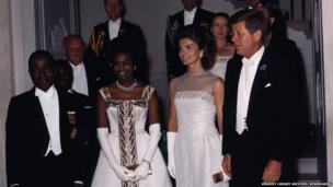 President John F Kennedy and Jacqueline Kennedy pose with President Felix Houphuet-Boigny of the Ivory Coast at the White House on 5 May 1962