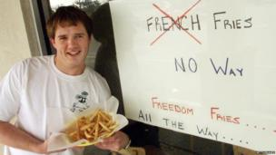 """Restaurant owner Neal Rowland holds a plate of his """"freedom fries"""" in February 2003 in Beaufort, North Carolina"""