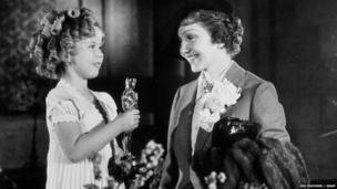 Shirley Temple and Claudette Colbert