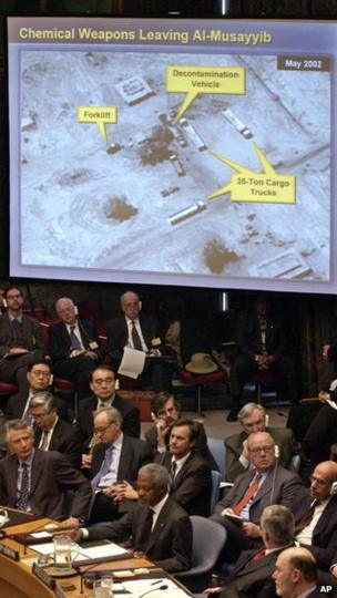 With a US State Department graphic above and French Foreign Minister Dominique de Villepin bottom left, US Secretary of State Colin Powell, not pictured, addresses the UN Security Council on 5 February 2003, to persuade members that Iraq was producing weapons of mass destruction