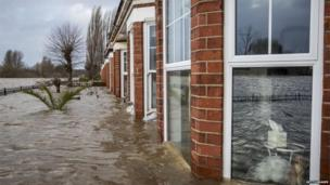 A row of terrace houses along the banks of the river were flooded on Wednesday.