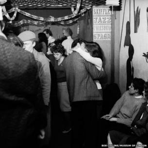 A couple kissing at a London party, c. 1955