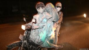 Residents evacuate in Malang, East Java