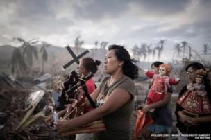 Survivors of typhoon Haiyan marching during a religious procession in Tolosa, Philippines