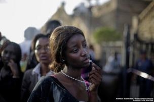 A woman reacting in disappointment after finding out that access to see former South African President Nelson Mandela was closed on the third and final day of his casket lying in state in Pretoria.