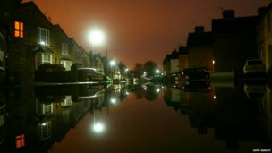 Flooded residential street in Staines-On-Thames, Surrey. Photo: John Ashley