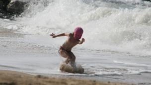 Waves and young girl surfing