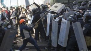 Police clash with anti-government protesters during a rally in Kiev