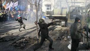 Stones thrown towards police during a rally near Ukraine's house of parliament in Kiev