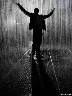Man in the Rain Room installation at the Barbican